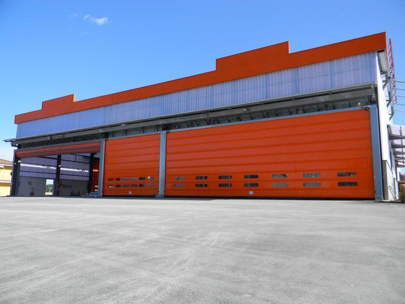 portoni industriali grandi dimensioni ad impacchettamento megapack